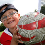 picture of boy holding football