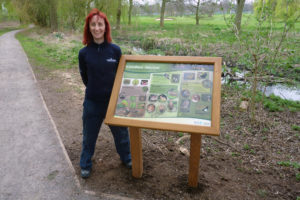 Ruth Piddington with the Woodland Habitat board