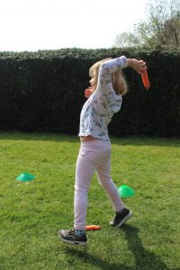 Girl throwing carrot